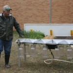 Jeff Hemenway, soil quality specialist for the NRCS, explains how the rain simulator works at an event in Brookings in April 2012. Photo by Heidi Marttila-Losure
