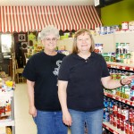 Lake Grocery manager Deb Holmstrom, right, and employee Dede Dylla are pictured next to the canned food section. The store has been under the ownership of Willow Lake Area Advancement for three years.