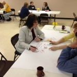 Paula Jensen discusses the topic of transportation with other participants in the Dakotafire Café in Britton on March 28. Photo by Joe Bartmann