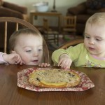 Elle Waldoch and Lucy Bartholomew are working on starting their own childhood memories of kuchen. The two girls are granddaughters of Sue Balcom of Mandan, N.D.