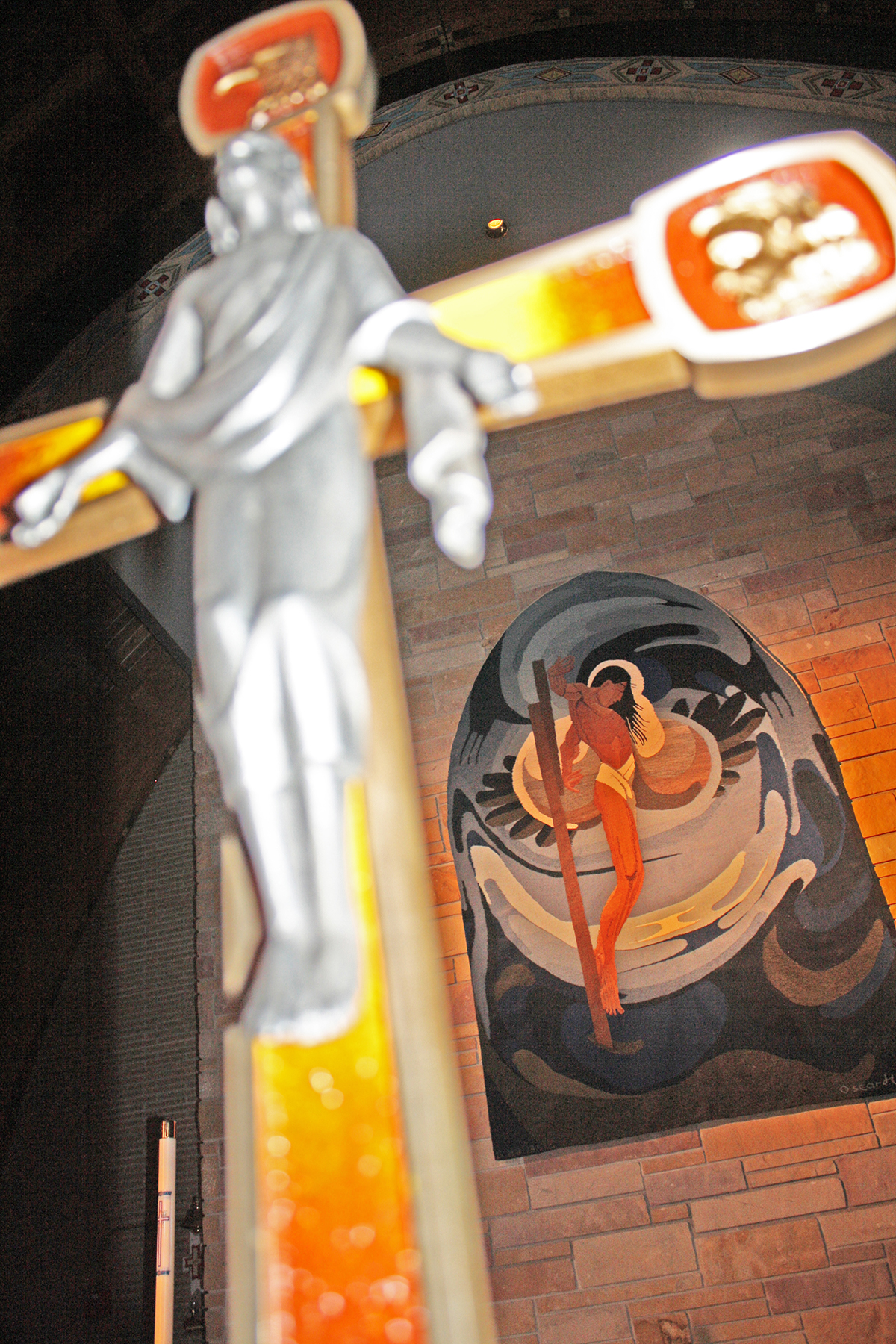 """""""Indian Christ,"""" a tapestry from an original painting by Oscar Howe, hangs over the altar in Our Lady of the Sioux Chapel at St. Joseph's Indian School. Photo by Wendy Royston/Dakotafire Media"""