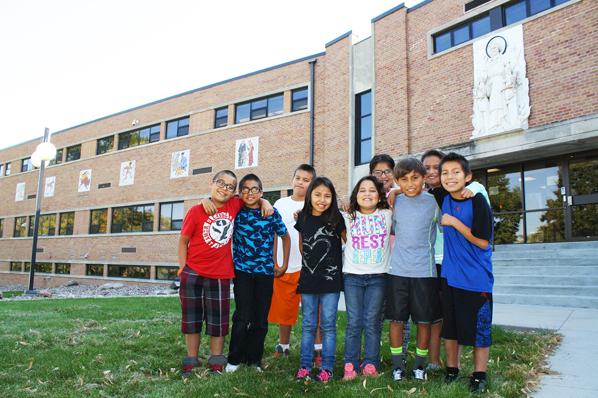 Fourth-graders at St. Joseph's Indian School share some smiles. Photo by Wendy Royston/Dakotafire Media