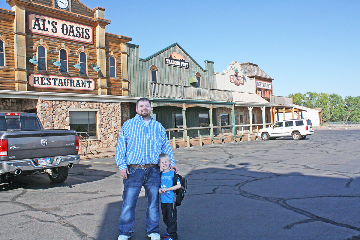 The food and experience at Al's Oasis in Oacoma hasn't changed much in 97 years, despite being sold to Regency Hotel Management in 2013, according to General Manager Craig Gill, pictured here with his son, Liam. Photo by Wendy Royston/Dakotafire Media