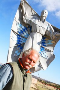 """Dale Lamphere stands before his creation, """"Dignity: Of Earth and Sky,"""" near Chamberlain, S.D. Photo by Wendy Royston/Dakotafire Media"""