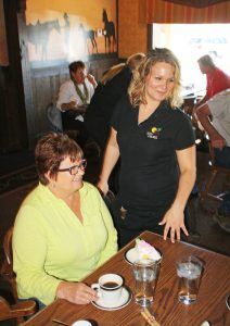Julie Mertz, left, of Chamberlain, S.D., shares homemade pie (served here by Shannon Dolezal) at Al's Oasis in Oacoma every Saturday with friends, and often brings out-of-towners there to dine. Photo by Wendy Royston/Dakotafire Media