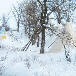 Three tipis sit camouflaged by trees and snow at the Lakota winter camp held by the Cloud Horse Art Institute on Pine Ridge Reservation. These camps, led by Tilda Long Soldier St. Pierre and her husband, Mark, offered native youth a firsthand understanding of their ancestors' experience of winter life, including astronomy, biology, cooking, games and storytelling. The camp was most recently held in 2010. Photo by Mark St. Pierre